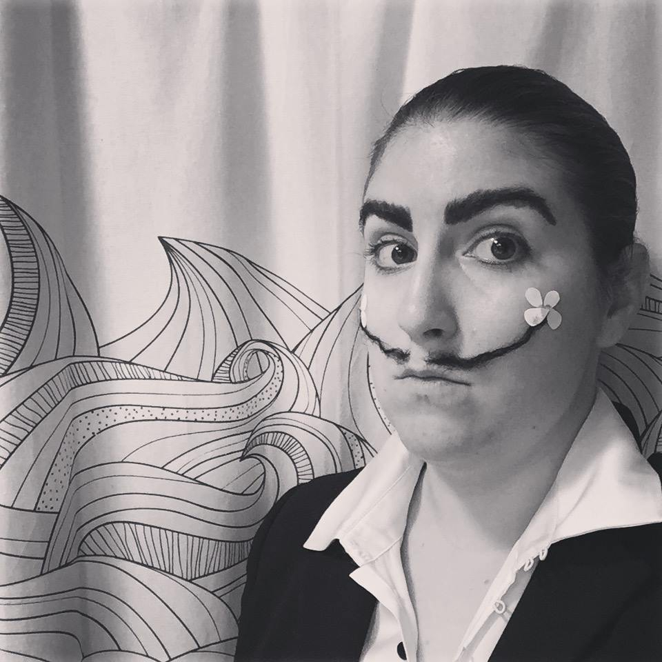 Girl dressed like Salvador Dali in black & white