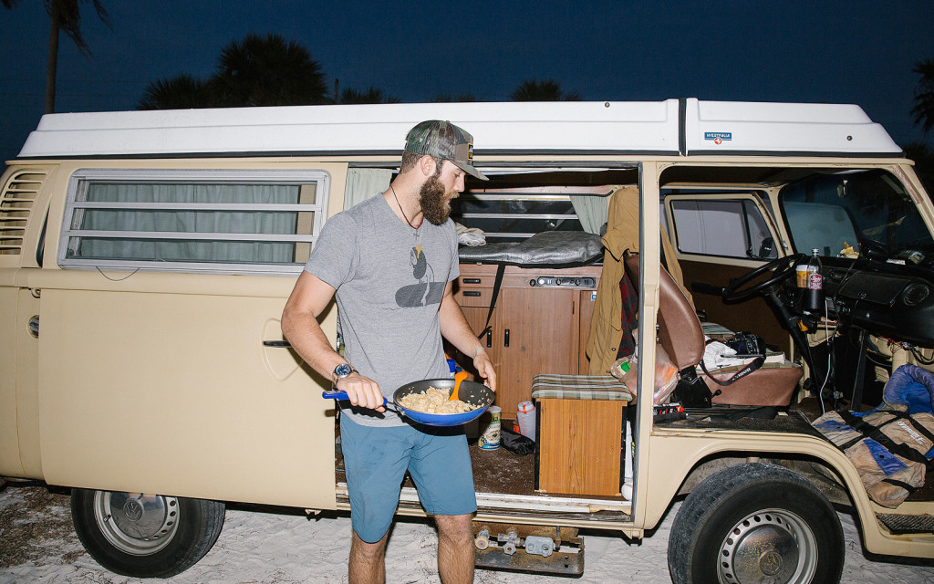 Daniel Norris getting into van with pan of food